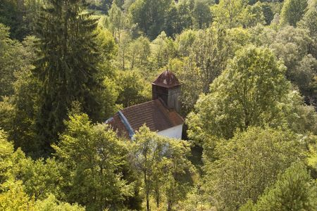 church in forest in abandoned village in romanian carpathian mountain Stock Photo
