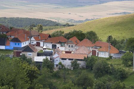 mountain village Jina in Transylvania Romania on hill top with highland in background