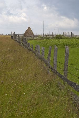property fence and hay stack in rural Transylvania Romania