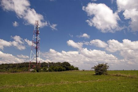 telecommunication gsm antenna on summer day at forest