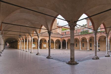 town square and street in Bologna with arches (portici) surrounding the public space