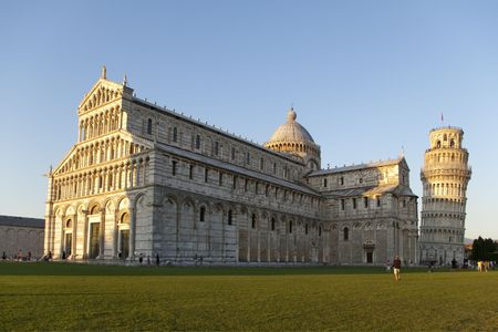 leaning tower and cathedral in Piazza dei Miracoli from Pisa Tuscany Italy in late evening golden light photo
