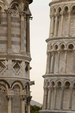 inclination: detail of Pisa leaning tower comparing the inclination against the church building