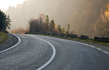 valley asphalt road in mountain in early morning light Stock Photo - 8199483