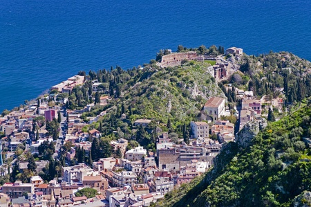 Town of Taormina in Sicily Italy in spring view from high point with greek theater photo