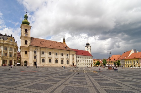 catholical: main square historical arhitecture in Sibiu Transylvania Romania catholical church public lantern and  Council Tower in background  Stock Photo