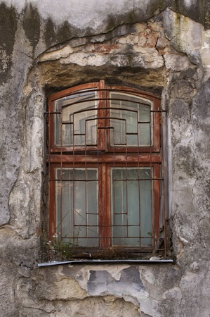 window in the deacayed old house photo