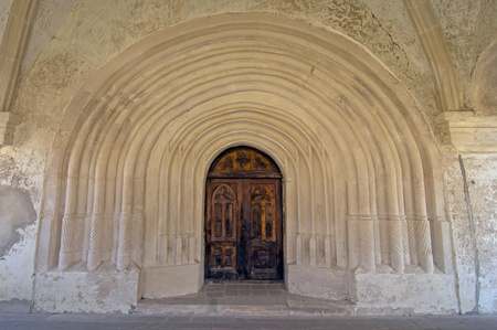 door and arches at church entrance inside Chotyn castle in Ukraine photo