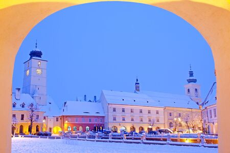 Winter in old town center Sibiu, small square (Piata Mica) all building covered with snow Stock Photo