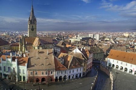 Aerial view of Sibiu old town in Transylvania, Romania, Lutheran cathedral tower and Small Square (Piata Mica)