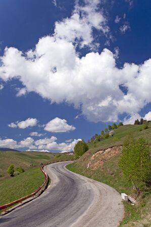 Mountain road curve in Romania Transylvania photo