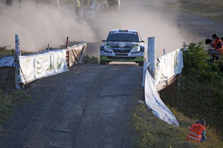 irc: SIBIU - JULY 20, 2012: Marco Tempestini in his car during 2012 IRC Intercontinental Rally Challenge - Eurosport on July 20, 2012 in Sibiu, Romania.