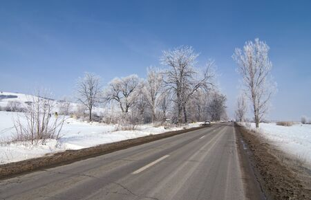Road in winter with snow, sunny bright day Stock Photo