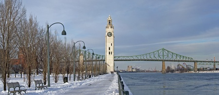 St. Lawrence River with Big Ben in Old Montreal, and Jacques-Cartier Bridge in background, winter season Stock Photo