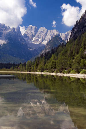 Mountain lake in Dolomites Alps Italy on bright sunny day
