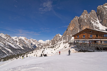 Ski slope and hut in Dolomites, Italy - Cortina D Editorial