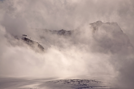 Misty mountain with cable car (gondola) in Austria, Oetztaler Alps photo
