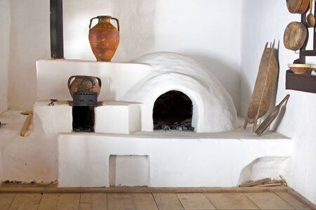 White beehive oven in traditional kitchen