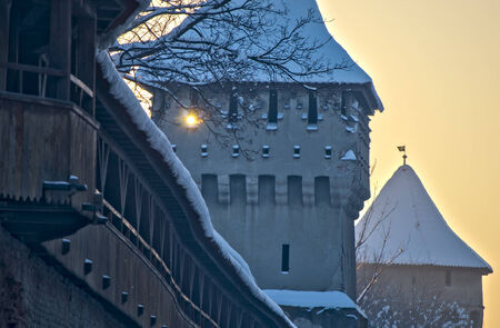 fortification: Sibiu, Romania - medieval 14th century fortification tower and wall in old town at twilight