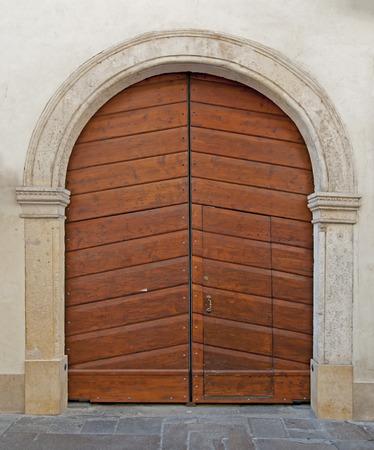 wood carving door: Wooden door on stone facade