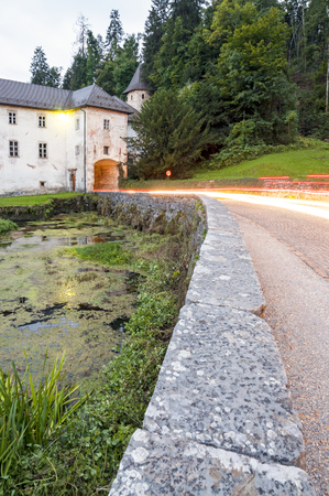located: Bistra Castle, located in the southwestern part of the Ljubljana, Slovenia - at dusk with light trails