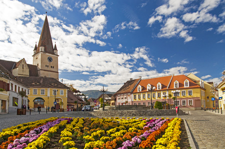 transylvania: Fortified church ans town square in Cisnadie, Transylvania, Romania Stock Photo
