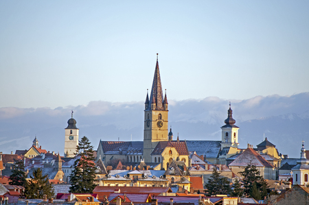 fagaras: Sibiu, cityscape in winter with Carpathians in background