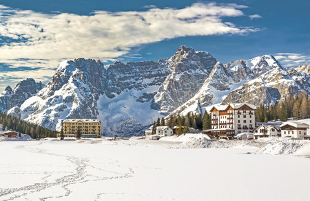 Panorama of mountain range from Misurina Lake resort in Dolomites, Italy in winter Stock Photo