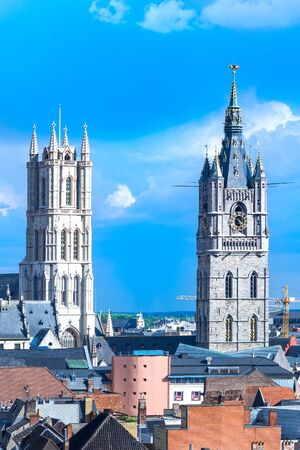 Cityscape in old town Gent of Belgium, belfry and cathedral tower Stock Photo