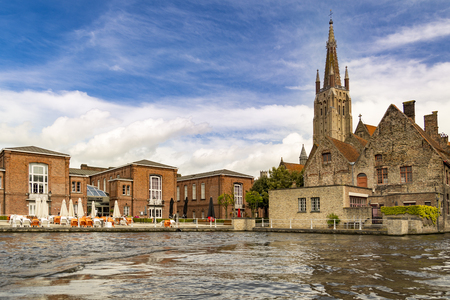 Brugge, Belgium - St Salvador cathedral tower view from water canal Stock Photo