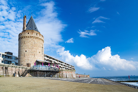 Old tower and promenade by Northern sea  in Vlissingen, Netherlands Stock Photo