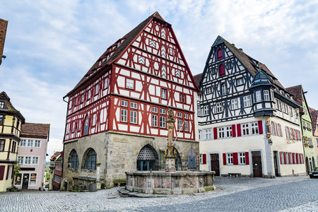 Timber framed houses and  St Georges fountain in Rotheburg ob der Tauber, medieval town, Germany