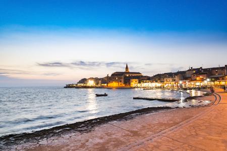 Umag, town in Istria peninsula, Croatia, at Adriatic Sea, viewed at sunset.