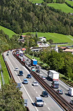 Traffic on Brennero highway crossing the Alps on summer day