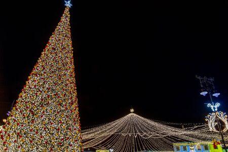 Christmas tree market and decoration lights in Sibiu main square, Transylvania, Romania
