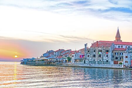 Umag, town in Istria peninsula, Croatia, at Adriatic Sea, viewed at sunset.