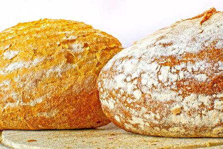 White and whole-wheat grain flour bread two cut loaf fresh baked