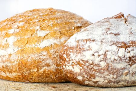 White and whole-wheat grain flour bread crust two loafs fresh baked
