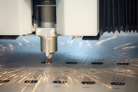 laser cutting: laser cutting machine technology industry background in factory Stock Photo