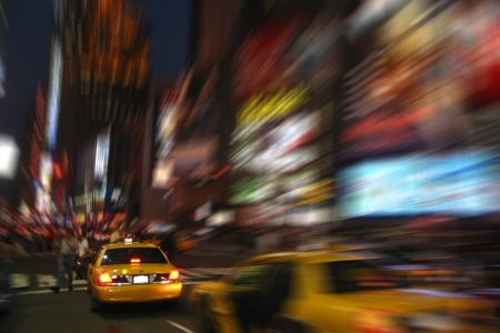 New York Cab Taxi at Times Square with Blur Effect photo