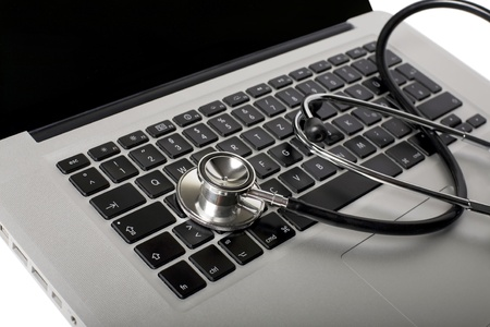 laptop with medicine stethoscope as a symbol Stock Photo - 8531101
