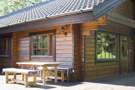 log cabin: Real Finish House Cottage in Summer and Blue Sky