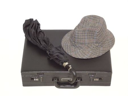 black briefcase: Black briefcase in horizontal position, with black umbrella and hat, isolated on white. (stock photo)