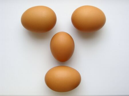 Face from four red eggs, isolated on white. (stock photo)