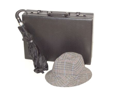 Black briefcase, in vertical position, with umbrella and hat, isolated on white.