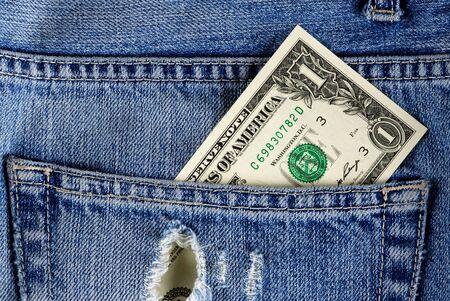 Dollar bill in jeans pocket photo