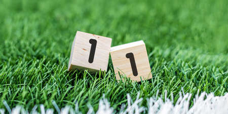 Dice show the result of a football match. The 1: 1 was scored. Or the 11 day of the month. 版權商用圖片