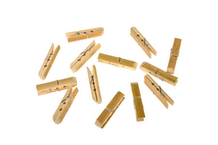 a lot of clothespins of bamboo on a white background