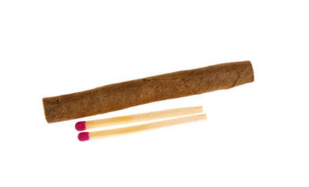 Cigarillos and matches on a white background Stock Photo
