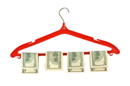 money is dried on a plastic hanger on a white background